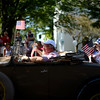 PAUL BILODEAU/Staff photo Parade goers wave as the antique car portion of the parade heads down Central Street during the annual Fourth of July, Manchester-by-the-Sea, parade
