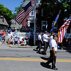 PAUL BILODEAU/Staff photo Members of the American Legion Post 113, Manchester-by-the sea, make their way down the parade route during the annual Fourth of July Manchester-by-the-Sea parade