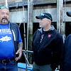 PAUL BILODEAU/Staff photo. Dave Marciano  talks with a veterans as the ready to head out fishing. Marciano of Wicked Tuna and Tom Orrell of the Yankee Fleet hosted a fishing trip to benefit the Wounded Warrior Project.