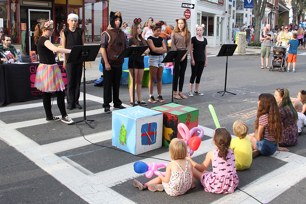 Vincenzo Dimino/Photo  From left, Gloucester Stage Youth Acting Workshop members Victoria Squire, Nate Oaks, Colby Taormina, Marissa Neves, Marissa Numerosi, Miranda Joyce and Meagan Gallo perform during the block party.
