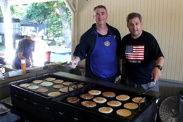 From left, state Rep. Brad Hill, R-Ipswich, and state Sen. Bruce Tarr, R-Gloucester, serve up pancakes.  <br /> <br /> Vincenzo Dimino/Photo