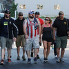 PAUL BILODEAU/Staff photo. A group of veterans and their families head to the dock at the backside of the State Fish Pier to head out fishing for the day. Dave Marciano of Wicked Tuna and Tom Orrell of the Yankee Fleet hosted a fishing trip to benefit the Wounded Warrior Project.