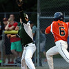DAVID LE/Staff photo. Manchester-Essex first baseman Thomas Steriti reaches for a throw that barely edges out Beverly's Charlie Mack in the District 15 Final on Thursday evening. 7/14/16.