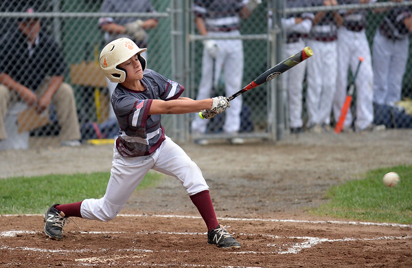RYAN HUTTON/ Staff photo<br /> Gloucester's Emerson Marshall swings away at a pitch in the top of the first inning of the District 15 Little League Final game against Beverly at Harry Ball Field in Beverly on Thursday.