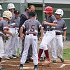 RYAN HUTTON/ Staff photo<br /> Gloucester's Carson Harwood is swarmed by his teammates as he crosses the plate after hitting a home run during the first at bat of the District 15 Little League Final game against Beverly at Harry Ball Field in Beverly on Thursday.