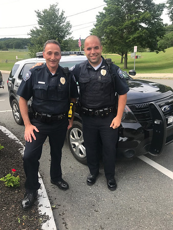 MARY MARKOS/Staff photo<br /> After 30 years as a police officer, 24 in Essex, Rob Gilardi, left, is officially retiring Saturday. Taking over his duties as the Essex police court prosecutor will be Patrolman Alex Edwards.