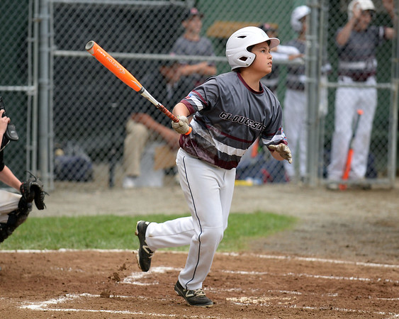 RYAN HUTTON/ Staff photo<br /> Gloucester's Zach Morris watches the ball he just hit sail over the outfield fence for a two-run homer in the top of the first inning of the District 15 Little League Final game against Beverly at Harry Ball Field in Beverly on Thursday.