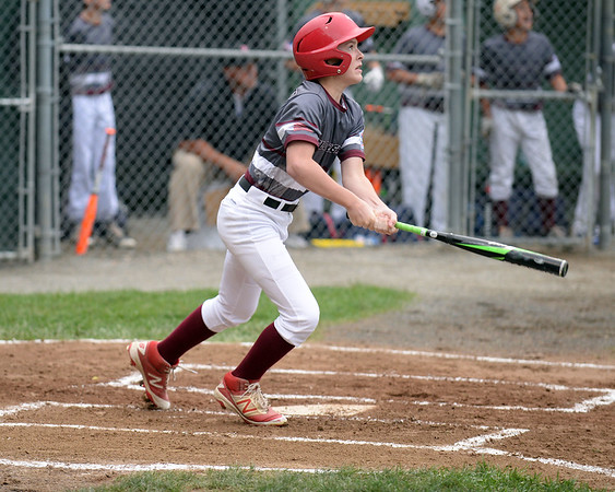 RYAN HUTTON/ Staff photo<br /> Gloucester's Carson Harwood watches the ball he just hit sail over the outfield fence to score a homer during the first at bat of the District 15 Little League Final game against Beverly at Harry Ball Field in Beverly on Thursday.