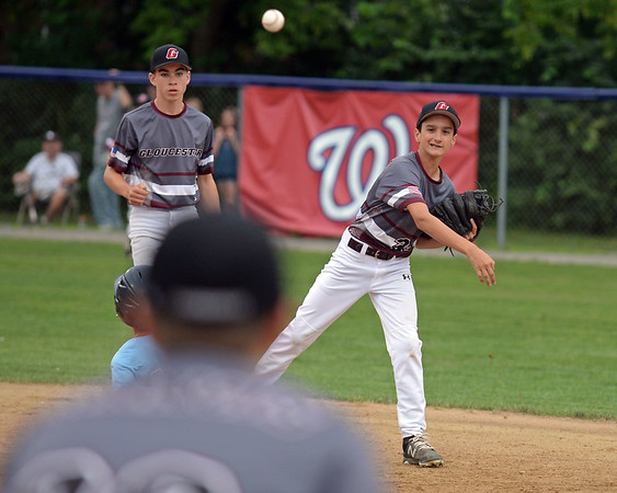 RYAN HUTTON/ Staff photo<br /> Gloucester's Drew Macchi fires the ball to first baseman Ryan Francis to try to make the out during the bottom of the first inning of Saturday night's Section 4 Little League championship against Peabody at Wyoma Field.