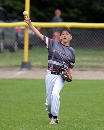 RYAN HUTTON/ Staff photo<br /> Gloucester's Daniel Hafey fires in the ball from left field in the bottom of the second inning of the District 15 Little League Final game against Beverly at Harry Ball Field in Beverly on Thursday.