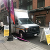"MARY MARKOS/Staff photo<br /> The shuttle bus ticket ""station,"" which looks like a food truck is parked across the street from North Station in Boston."