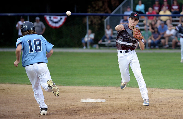RYAN HUTTON/ Staff photo<br /> Gloucester's Jared Lucido fires the ball to first for the double play after making the out at second against Peabody's Ryan Rice during the bottom of the fourth inning of Saturday night's Section 4 Little League championship against Peabody at Wyoma Field.