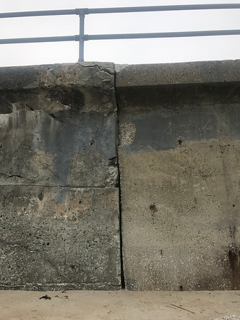 MARY MARKOS/Staff photo<br /> A Rockport committee has been tasked with formulating plans to repair the Long Beach seawall. Here, the contrast can be seen between the 1930s concrete, left, mixed with small stones, and the more advanced 1950s concrete.