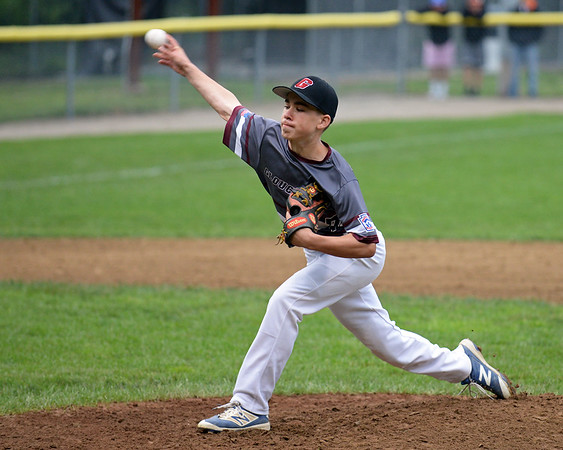 RYAN HUTTON/ Staff photo<br /> Gloucester's Jared Lucido fires in a pitch in the bottom of the first inning of the District 15 Little League Final game against Beverly at Harry Ball Field in Beverly on Thursday.