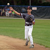 RYAN HUTTON/ Staff photo<br /> Gloucester's Drew Macchi tosses the ball to first to make the out during the bottom of the first inning of Saturday night's Section 4 Little League championship against Peabody at Wyoma Field.