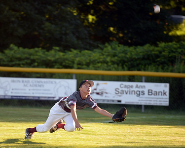 RYAN HUTTON/ Staff photo Gloucester's Emerson Marshall dives for the ball during the bottom of the fourth inning of Wednesday's game against Danvers at Boudreau Field in Gloucester.