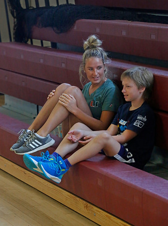 MIKE SPRINGER/Staff photo<br /> Coach Allie Davis talks with 12-year-old Addie Gardner during a break Tuesday in the Cape Ann Basketball Clinic at Rockport High School.<br /> 6/16/2019