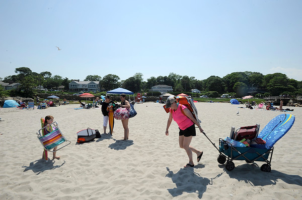 Joseph Prezioso/PhotoJenna Sigman of Danvers hauls her beach wagon through the sand at Good Harbor Beach on July 3. a hot Wdnesday, where temperatures reached the mid 80s.  The forecast calls for temperatures in the high 70s to low 80s through Saturday.