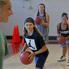 MIKE SPRINGER/Staff photo<br /> Students, from left, Amiah Gabriele, Madison Battle and Samahara Salah, all 12 years old, keep their eyes on coach Allie Davis during a ball-handling drill Tuesday during the Cape Ann Basketball Clinic at Rockport High School.<br /> 6/16/2019