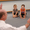 MIKE SPRINGER/Staff photo<br /> Brothers Colby, 4, and Colton Riley, 6, listen to instructor John Mahaney of Uechi Ryu Karate during an introductory karate lesson for children Tuesday at the Sawyer Free Library in Gloucester.<br /> 6/16/2019