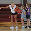 MIKE SPRINGER/Staff photo<br /> Coach Rachel Davis teaches River Martin, 8, and Nashaia Weaver, 8, a drill Tuesday during the Cape Ann Basketball Clinic at Rockport High School.<br /> 6/16/2019