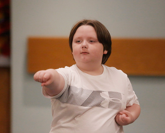 MIKE SPRINGER/Staff photo<br /> Eight-year-old Chase Lakeman takes part in a karate class Tuesday at the Sawyer Free Library.<br /> 6/16/2019