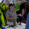 TIM JEAN/Staff photo<br /> <br /> Erin Lally, Field Research Coordinator at Northeast Center for Occupational Health and Safety talks with a local resident about the Lifejackets for Lobstermen campaign tent at the Jodrey State Fish Pier in Gloucester.  7/17/19