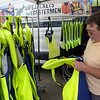 TIM JEAN/Staff photo<br /> <br /> Lobster Boat Captain Mark Ring, of Gloucester, looks over the display of lifejackets from the Lifejackets for Lobstermen campaign tent at the Jodrey State Fish Pier in Gloucester.  7/17/19