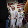 Desi Smith/Staff photo.  Class Vice President Maya Rowen (left) and Class President McKenzie Beaton (right) make their past family and friends to their seats during Graduation Ceremony at Rockport High School Friday night.    June 3,2016