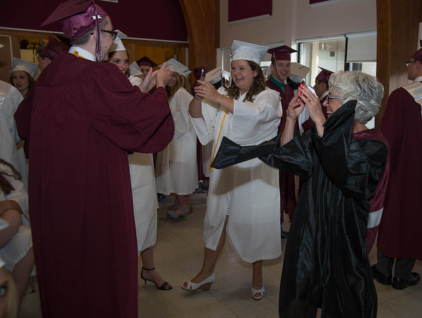 Desi Smith/Staff photo.  Bethann Kardenetz (right) Co Advisor of the Class of 2016,do a celebration dance with students Nick Endicott,Mary Colussi and Kate Kennedy while waiting to enter the gymnasium for the 2016 Graduation Ceremony held at Rockport High School Friday night.    June 3,2016