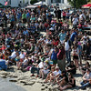 Crowds gather at Pavilion Beach to watch the Seine boat races and the Greasy Pole on Sunday.