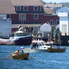 Photo by Allegra Boverman. Gloucester: During the 64th annual Intenational Dory Races held in Gloucester's Inner Harbor on Saturday morning. During the Senior's division race the Joel George of the Canadian team took ill and had to be rescued and taken to the hospital, at right.