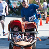 Desi Smith/Photo.    Will Flynt of Newton,Mass, waves to family as he crosses the finish with his sons Teddy 3, and Charlie 1-1/2 in the Rockport Father's Day 5k Road Race held Sunday morning at Rockport High School.    June 19,2016