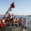Kyle Barry is carried ashore after winning Sunday's Greasy Pole.