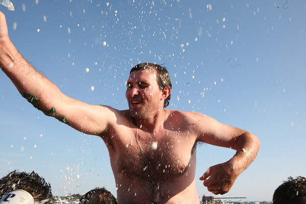 Kyle Barry is sprayed with beer after winning  the Greasy Pole on Sunday.