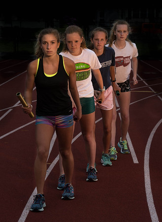 Desi Smith/Staff photo.  GHS 4x800m relay team front to back,Carly Curcuru, Leah Rudolph,Eve Feverbach and Niamh Dalton.     June 2,2016