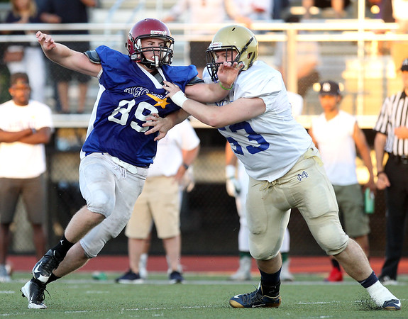 DAVID LE/Staff photo. Gloucester defensive lineman John Philpott blows past a south offensive lineman while rushing the quarterback in the 55th Agganis game on Thursday evening. 6/30/16.