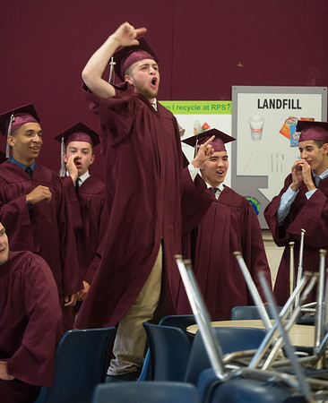 Desi Smith/Staff photo.  Thomas Boucher chants out USA_USA with his classmates while waiting to enter the gymnasium for the 2016 Graduation Ceremony held at Rockport High School Friday night.    June 3,2016