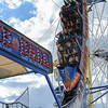AMANDA SABGA/ Staff photo <br /> <br /> Thuy Nguyen, of Gloucester, and Marty Vo, of Quincy, lead the Fire Ball as it begins its upside-down route at the Fiesta Shows carnival during the annual Gloucester St. Peter's Fiesta<br /> <br /> <br /> 6/22/16