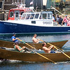 Photo by Allegra Boverman. Gloucester: During the 64th annual Intenational Dory Races held in Gloucester's Inner Harbor on Saturday morning. During the Senior's division race the U.S. team, front, of Joe Cominelli and Jimmy Tarantino, and the Canadian team of Joel George and Robert Fox, are neck and neck as they got started.