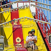 AMANDA SABGA/ Staff photo <br /> <br /> Jay Frontierro and his daughter Madeline, 4 of Hamilton, ride the Super Slide at the Fiesta Shows carnival during the annual Gloucester St. Peter's Fiesta<br /> <br /> <br /> 6/22/16