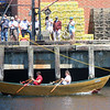 Photo by Allegra Boverman. Gloucester: During the 64th annual Intenational Dory Races held in Gloucester's Inner Harbor on Saturday morning. During the Master's division race the U.S. team, John Scola and Mike Harmon cross the finish line.