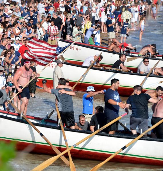 The Nina's crew celebrate their win in the senior Seine Boat Race.