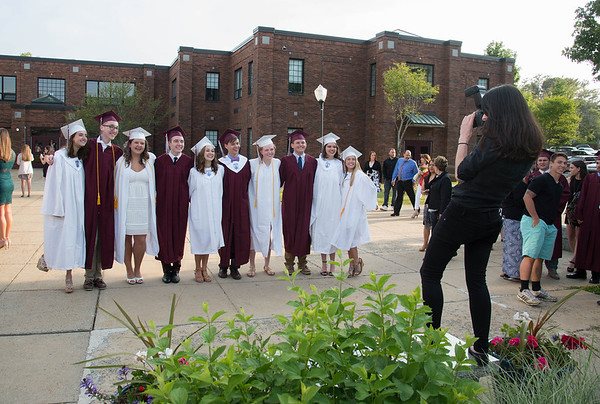 Desi Smith/Staff photo.  Photographer Sierra Partlan (right) of Hockmeyer Studios in Amesbury,takes some photos of students before heading in for their 2016 Graduation Ceremony held at Rockport High School Friday night.    June 3,2016
