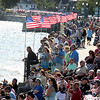Crowds gather at Pavilion Beach to watch the Seine boat races and the Greasy Pole during Fiesta 2016.