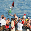 Kyle Barry is carried to shore after winning Sunday's Greasy Pole contest.