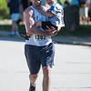 Desi Smith/Photo.     Joseph Dussault of Chelmsford,Mass,carries his son Jack 3, across the finish during the Rockport Father's Day 5k held Sunday morning at Rockport High School. Joseph met his wife 5 years ago at this race.    June 19,2016
