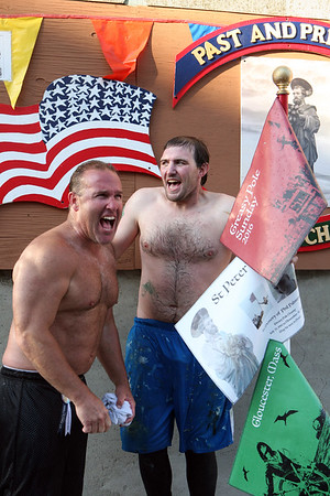 .Steve LeBlanc and Kyle Barry celebrate Kyle's win in the the Greasy Pole on Sunday.
