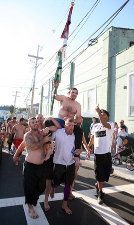 Kyle Barry is carried through the Fort after winning the Greasy Pole in the first round.