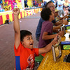 HADLEY GREEN/ Staff photo<br /> Danny Esteban of Gloucester cheers after winning a water gun game at the carnival for St. Peter's Fiesta in Gloucester. 6/22/17